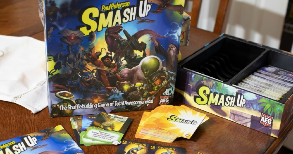 Smash Up Card Game on table with cards and instructions out