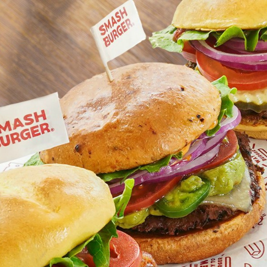 Burger with jalapenos and pepperjack cheese with two other burgers from Smashburger