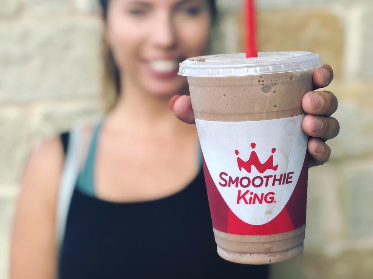 woman holding Smoothie King Chocolate Smoothie