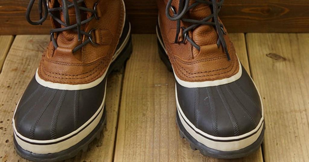 Sorel Caribou Boots on wood deck