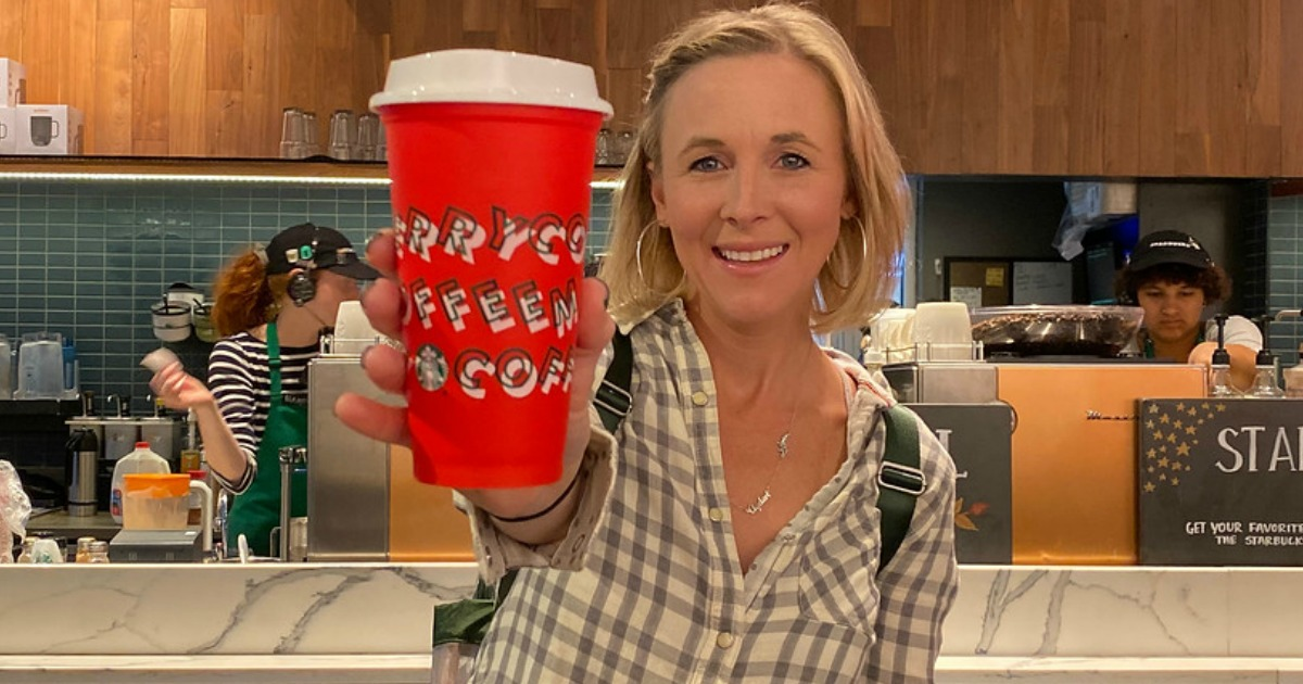 woman holding a Starbucks Free cup