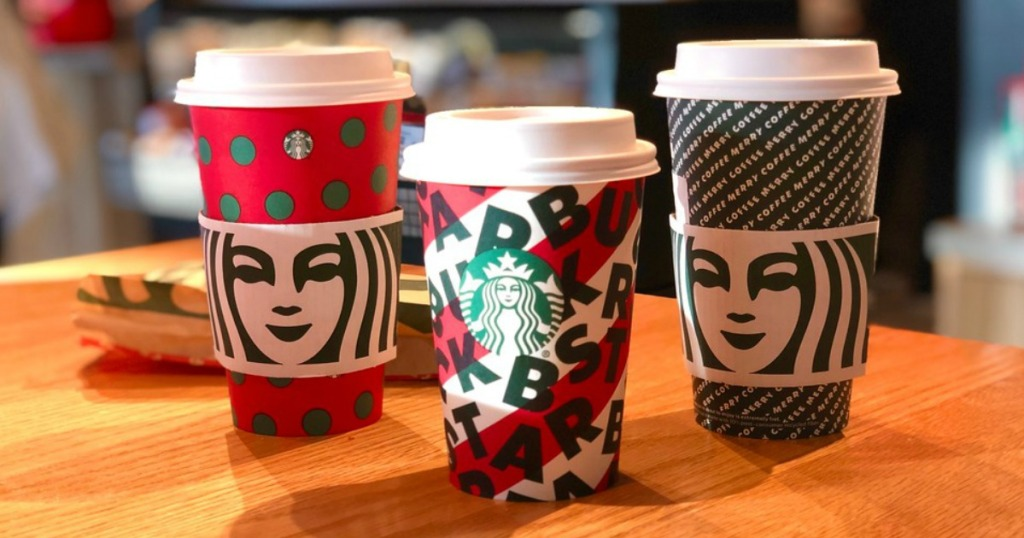 Starbucks cups sitting on a table
