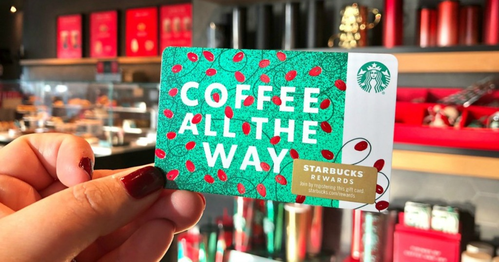 Woman holding christmas themed Starbucks Gift Card