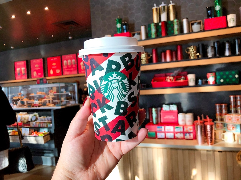 Person holding Starbucks Holiday Cup
