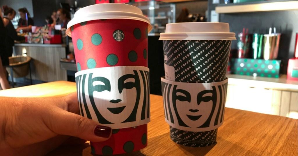 Woman holding Starbucks Holiday Drinks