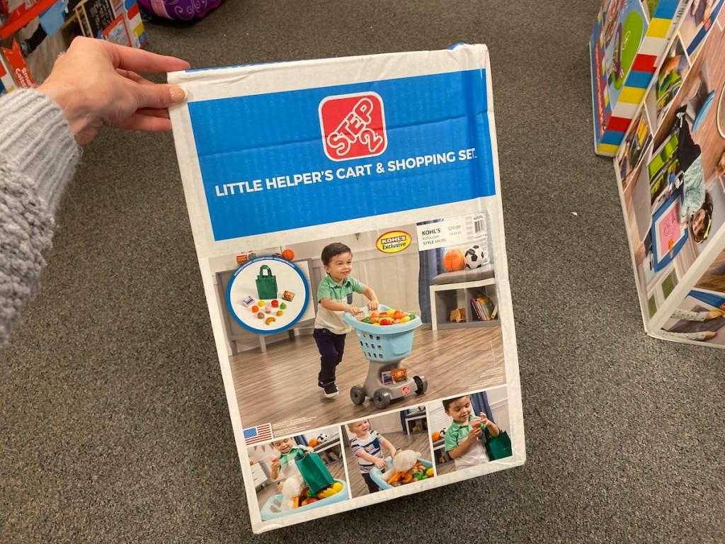 hand holding Step2 Shopping Cart Set box