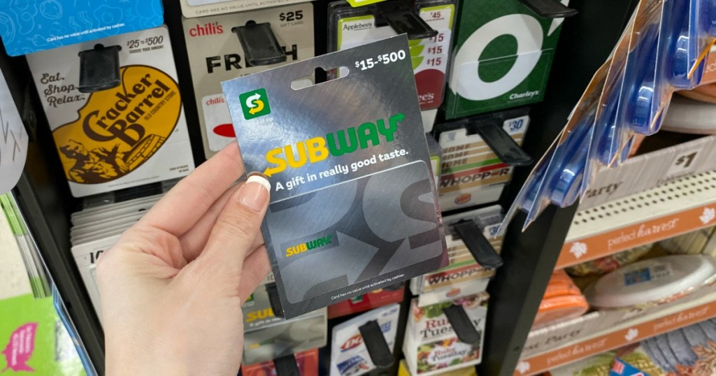 hand holding Subway Gift card