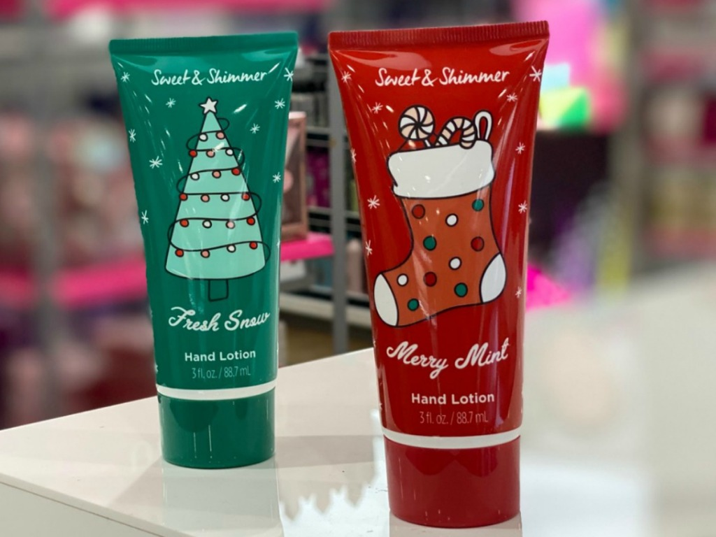 Two holiday hand lotion bottles