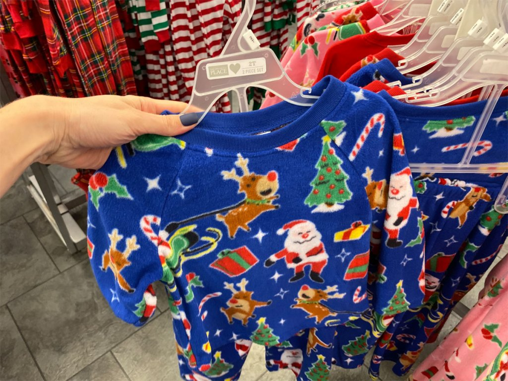 hand holding a pair of TCP home for the holidays pajamas