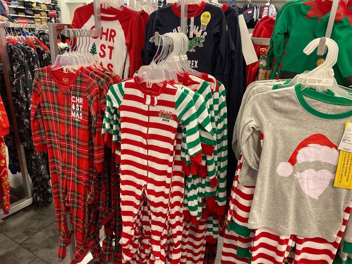 The Children's Place christmas pajamas hanging on racks