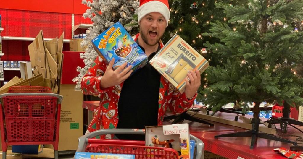 man at Target black friday shopping - buying games