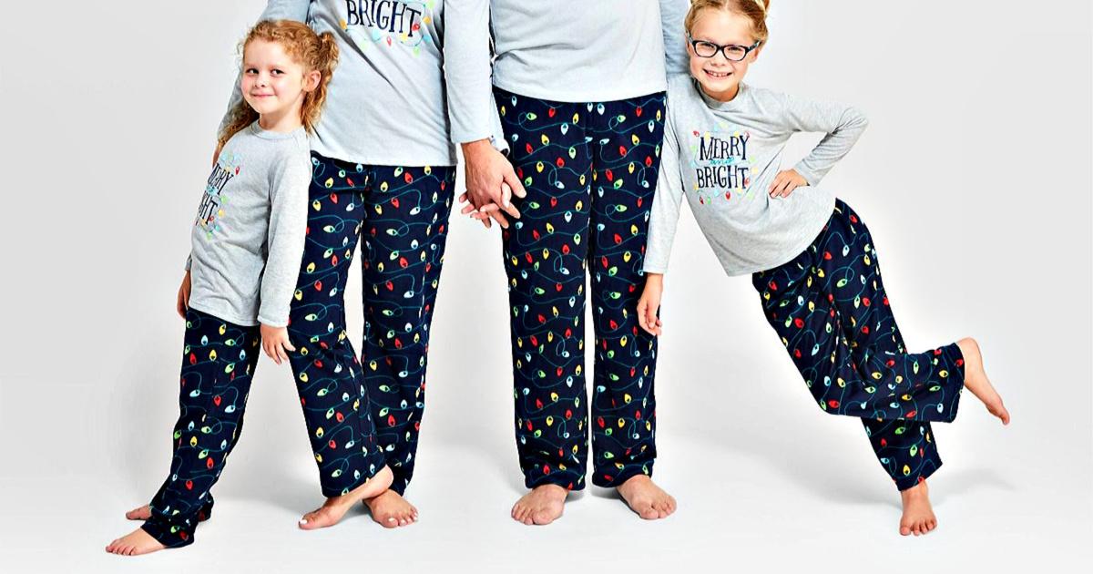 family wearing Christmas ornament fleece PJ pants