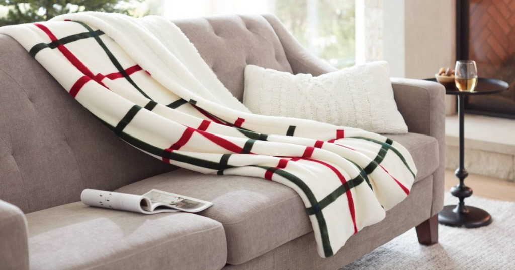 Holiday Sherpa Blanket draped on couch