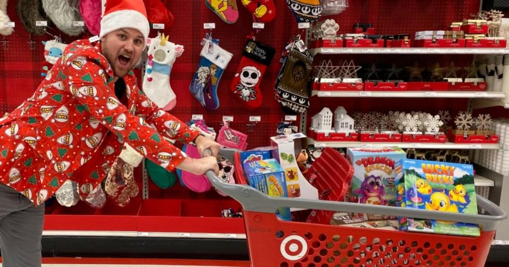 Steton pushing cart full of Target Toys