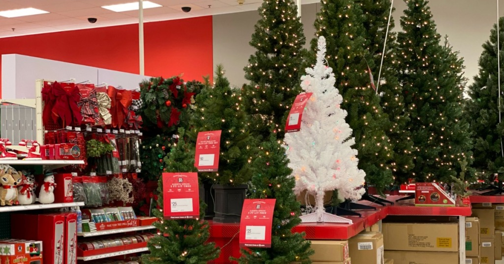 artificial christmas trees on display in a store