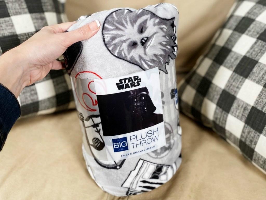 Star Wars print throw blanket in package on sofa