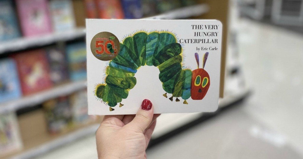 The Very Hungry Caterpillar by Eric Carle being held by a woman