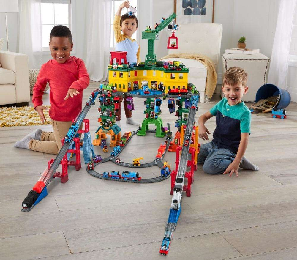boys playing with Thomas Super Station Track Set