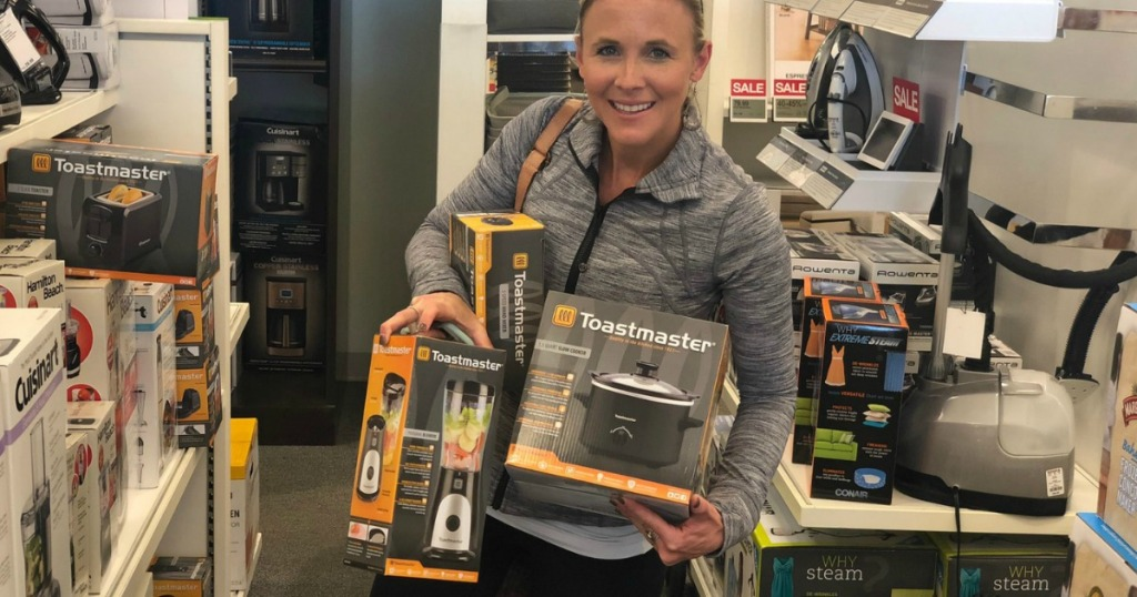 Woman holding three Toastmaster Appliances at Kohl's