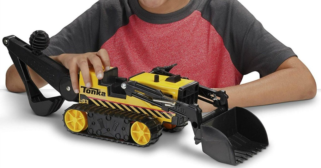 boy playing with Tonka Trencher