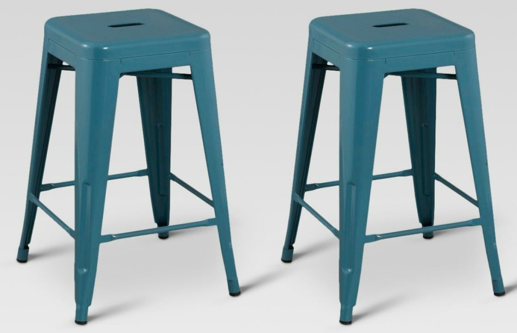 Two metal stools in teal