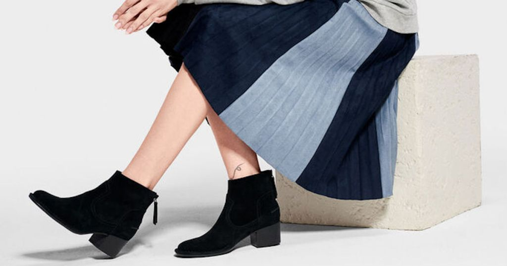 woman in blue thick striped dress wearing black UGG Bandara Ankle Bootie