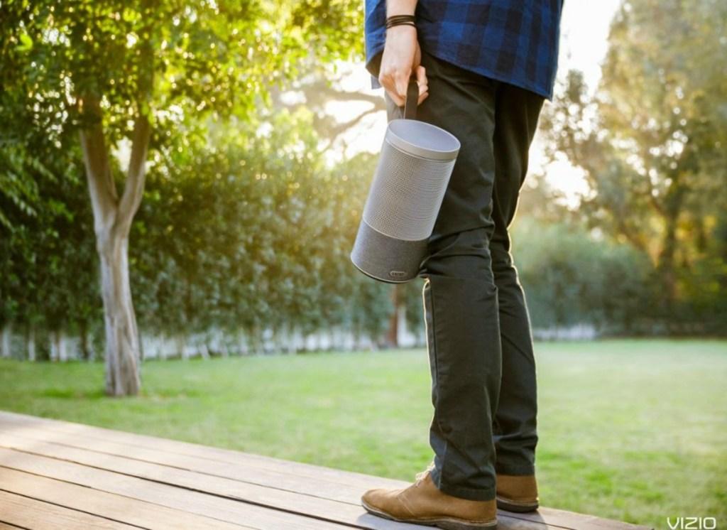 man holding a portable speaker