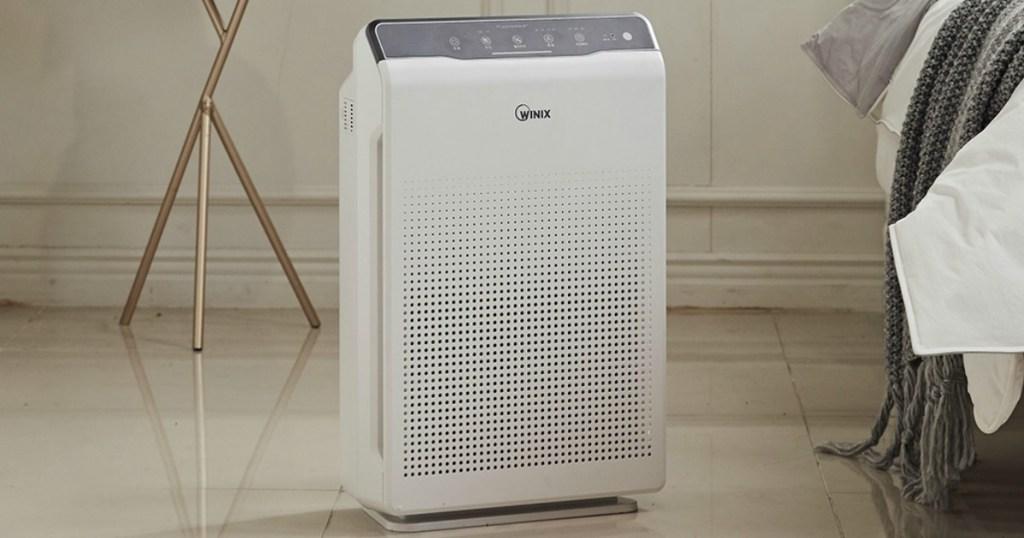 Winix C535 True HEPA Air Cleaner in bedroom on tiled flooring