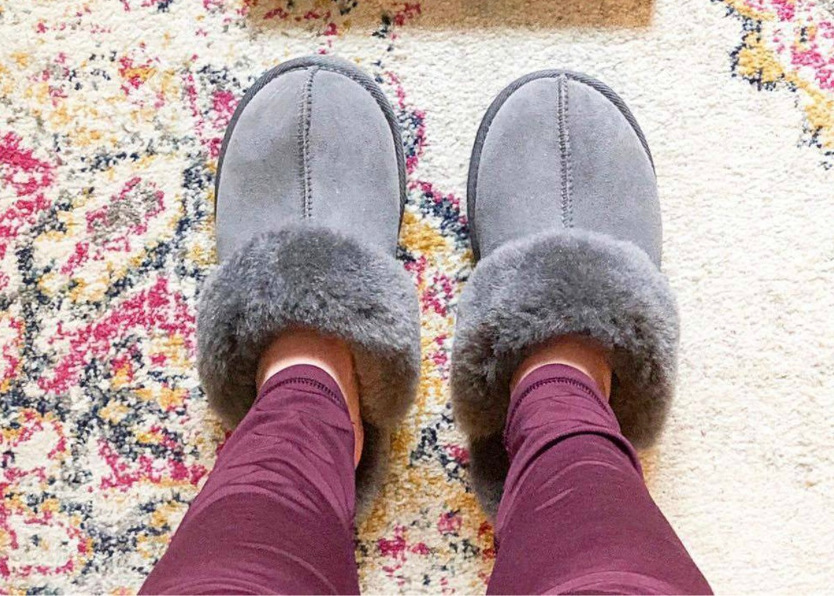 Woman wearing gray slippers