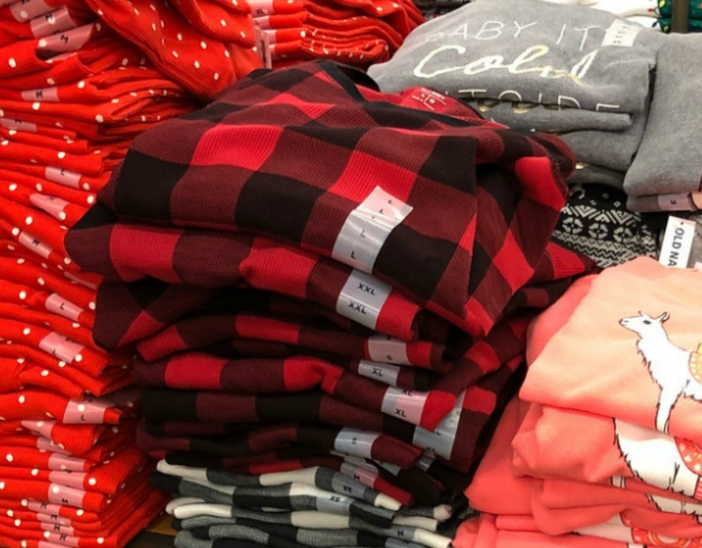 Women's Thermal tees in various styles stacked on display in-store