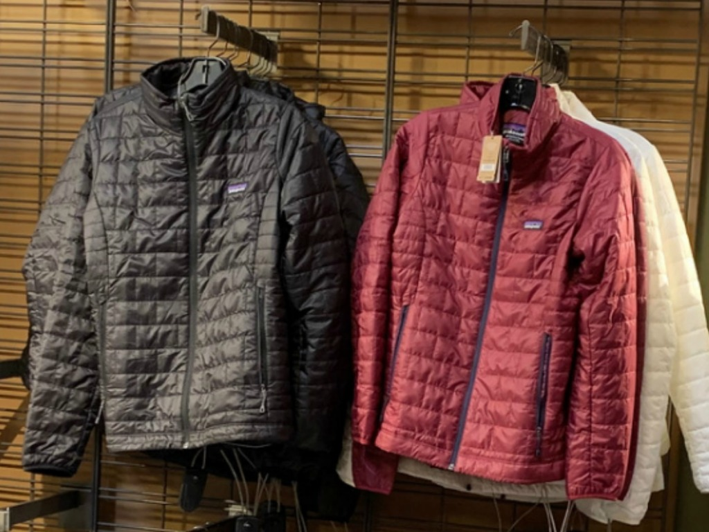 Women's Patagonia Puffer Coats on display at REI