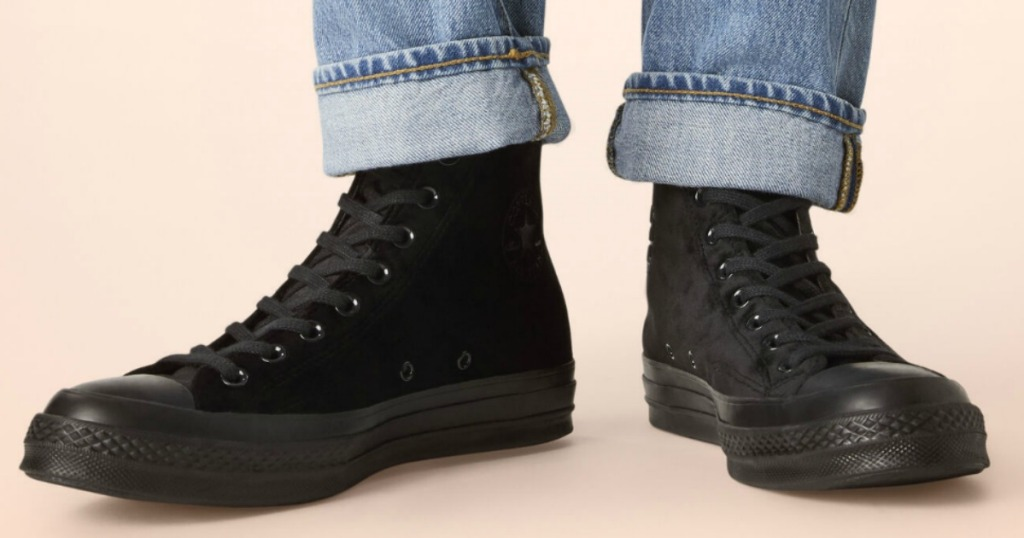 Woman wearing black velvet high tops