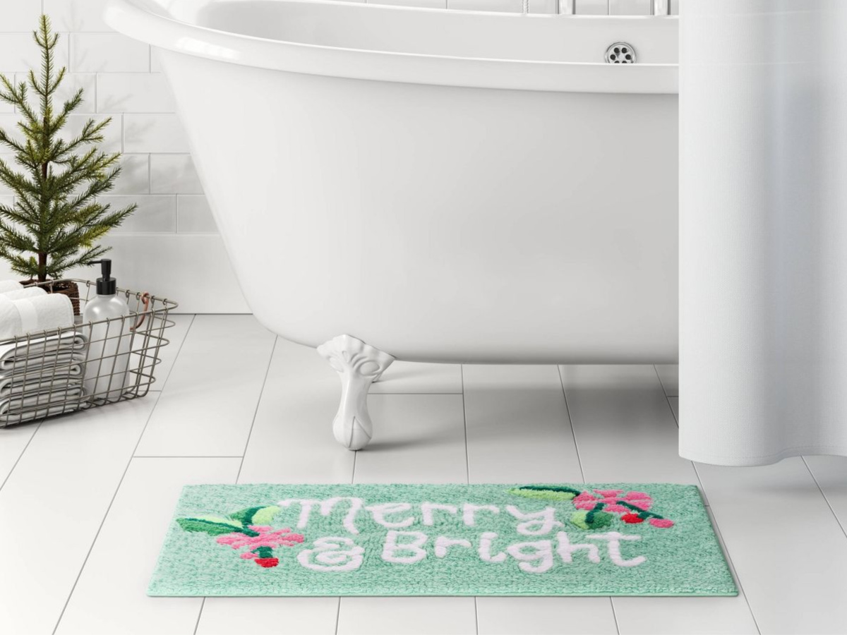 merry & bright bath rug in front of white tub