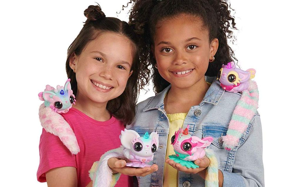 girls holding WowWee Pixie Belles Interactive Enchanted Animal Toy