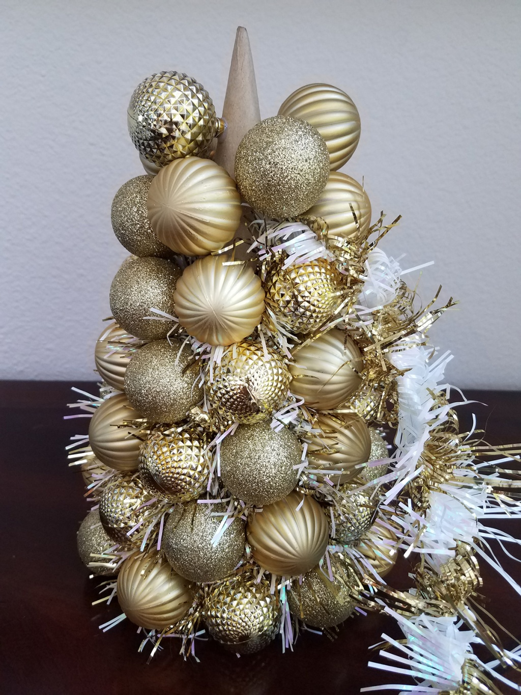 Adding white and gold garland to gold ornament centerpiece