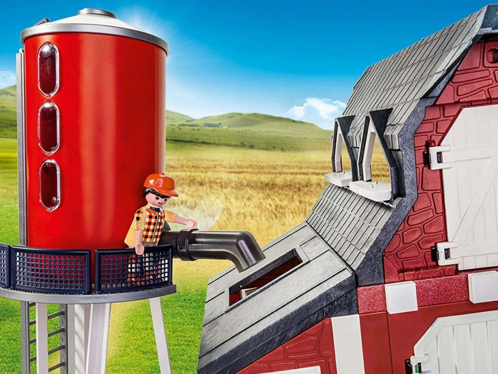 little play toy on silo with barn