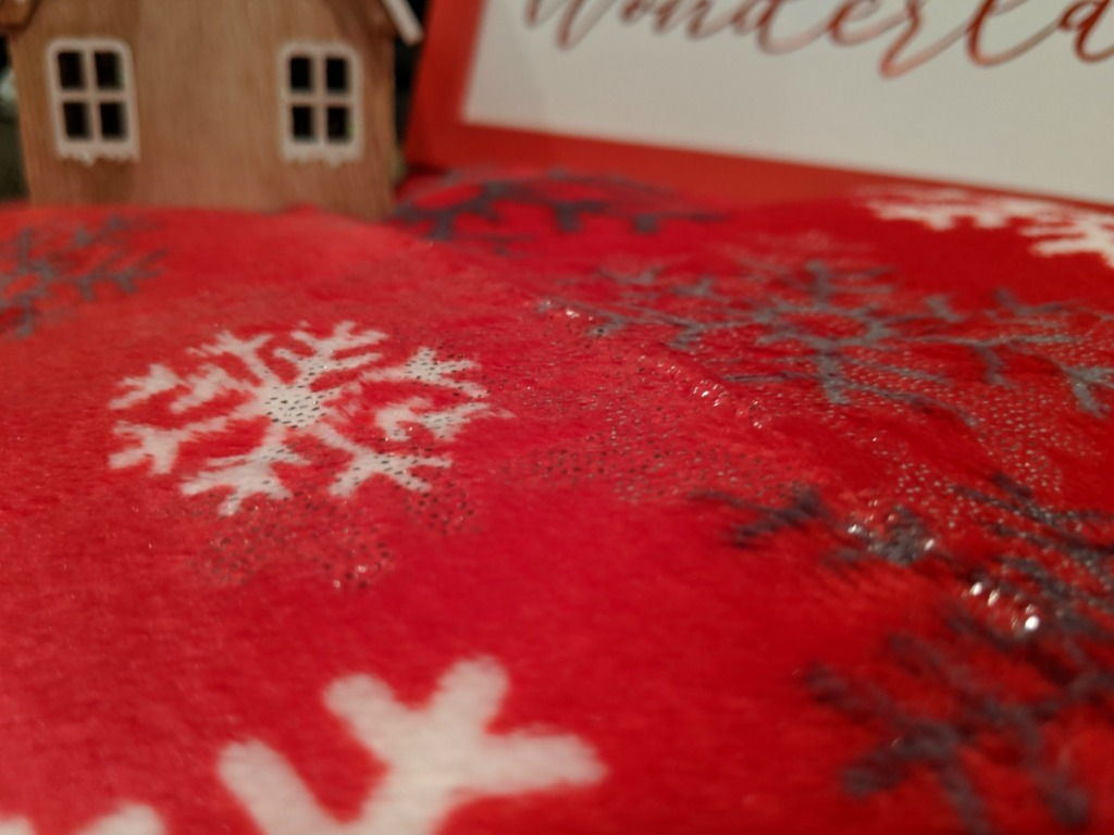 red blanket with snowflakes on it