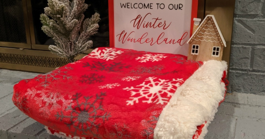 blanket folded on fireplace by holiday decor