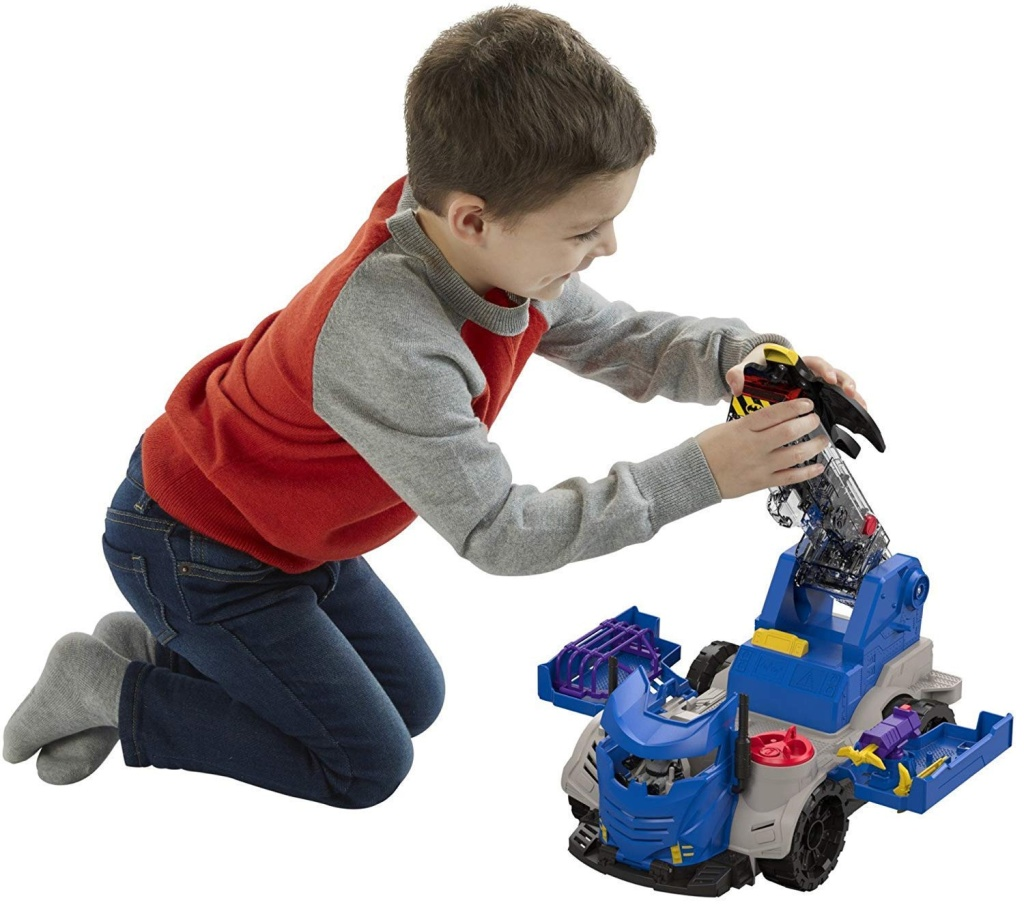 boy playing with Imaginext DC Super Friends, R/C Mobile Command Center