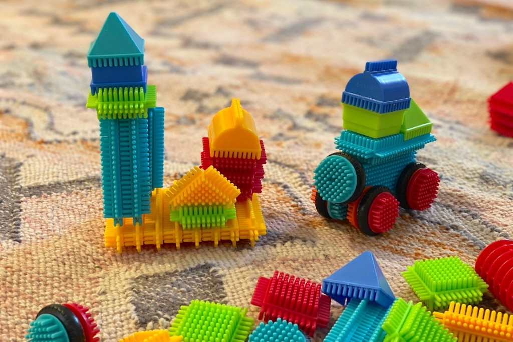 colorful bristle blocks with shapes on floor