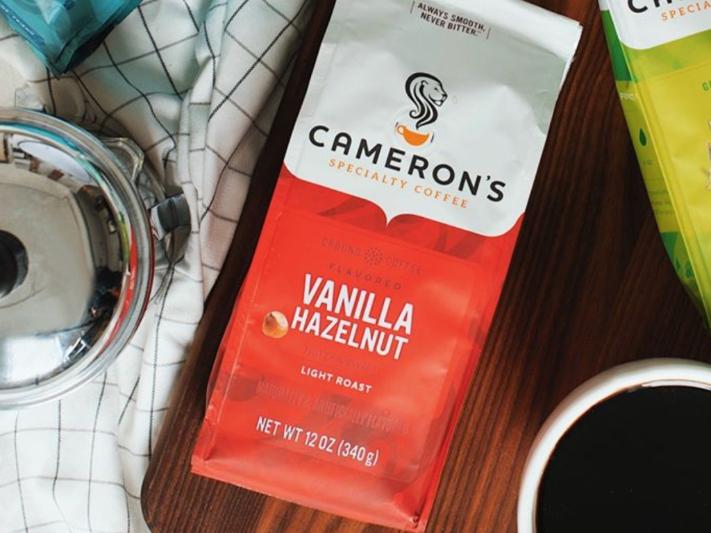 cameron's coffee vanilla hazelnut on counter with cup of coffee next to it