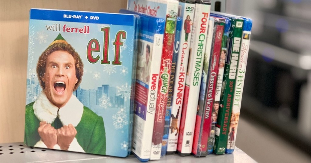 elf and other christmas movies stacking in a row on store shelf
