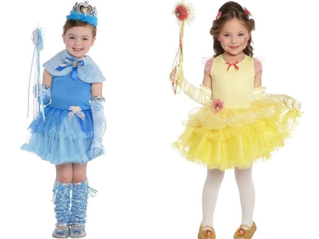 girls wearing halloween princess dresses