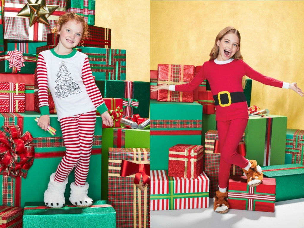 girls by presents wearing pajamas