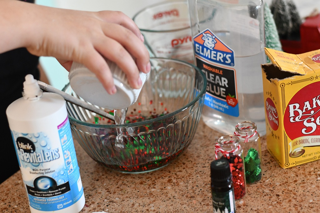 pouring contact solution into slime recipe