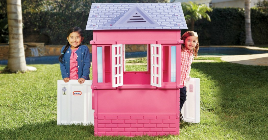playhouse with 2 little girls outside