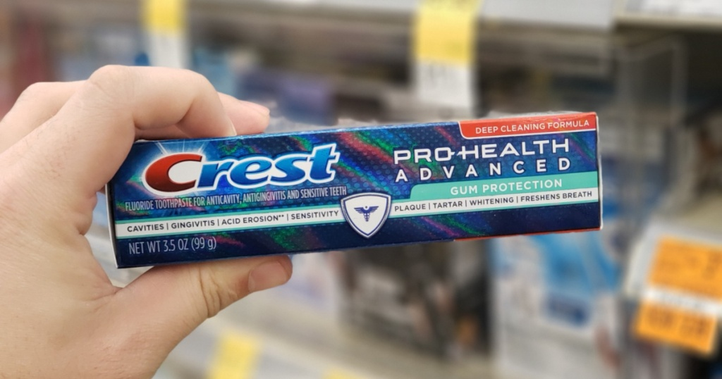 hand holding up box of crest pro health toothpaste