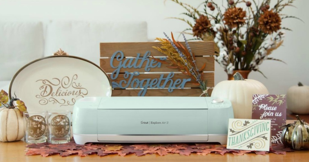 craft machine surrounded by fall decor