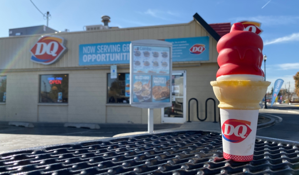 Dairy Queen cherry dipped cone on picnic table