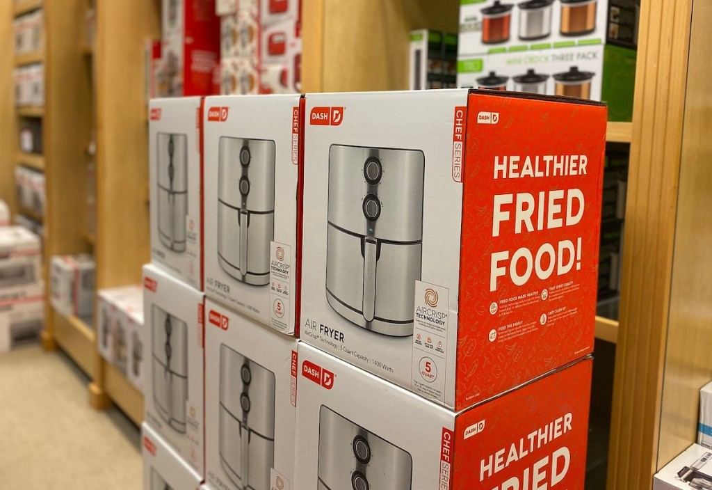 dash air fryer boxes stacked in store